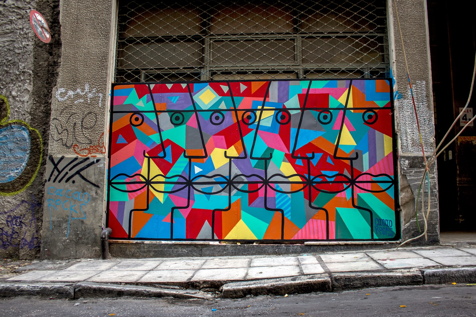 Greek Street Artist paints a new urban art mural on the streets of Athens in Greece. 1