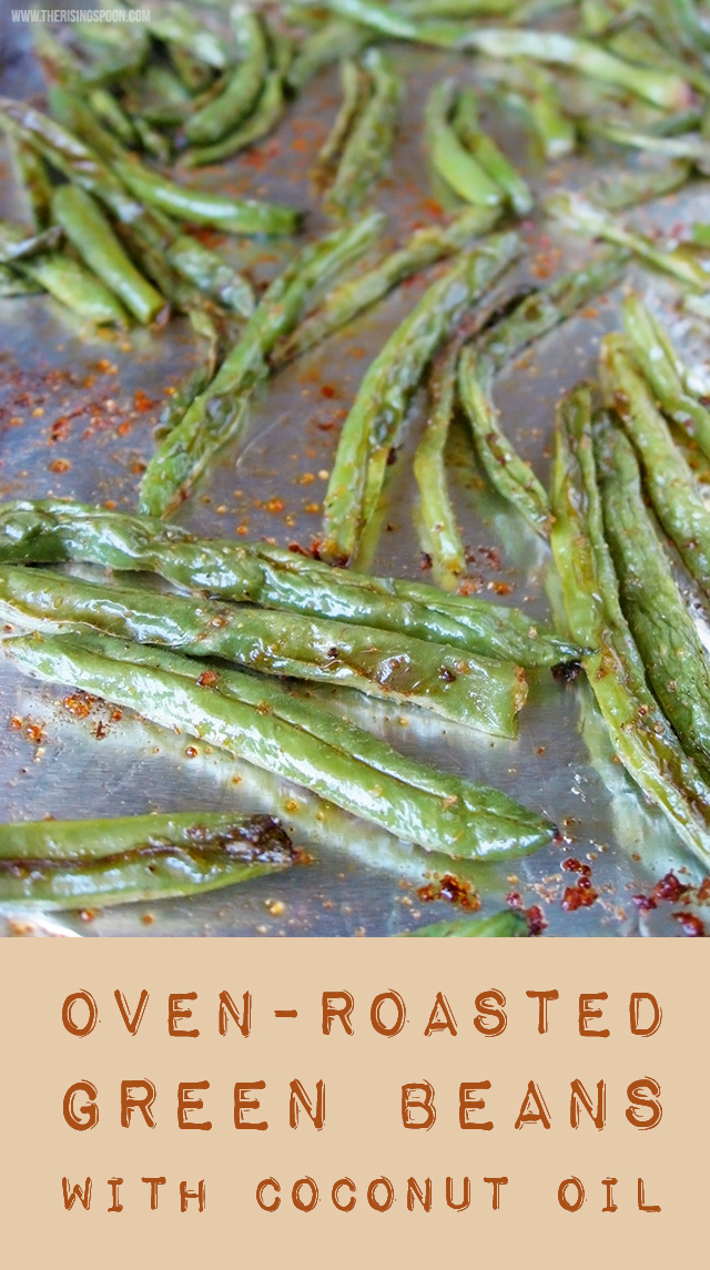 An easy recipe using fresh green beans tossed with organic coconut oil and spices, then quick roasted in the oven until tender, slightly caramelized and crispy around the edges.
