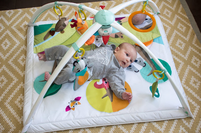 Tiny Love Gymini Deluxe Review with a baby on the play gym