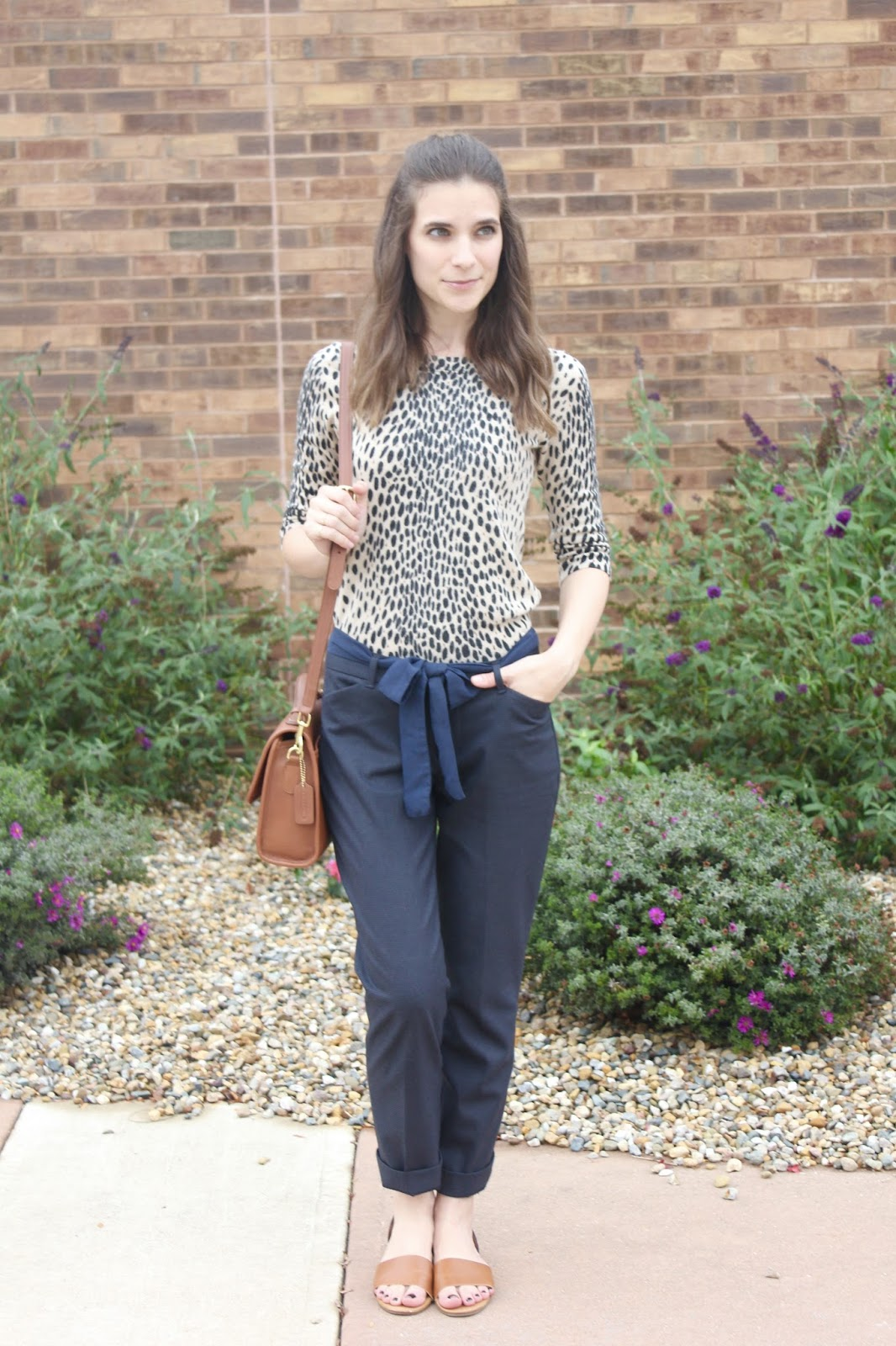 animal print top and navy pants