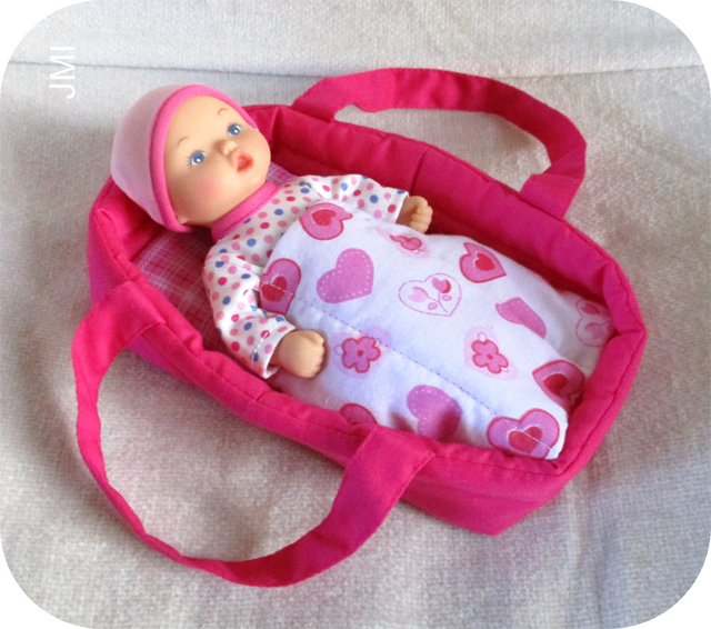 Learn how to make a portable carry bed for a baby doll. Tutorial by Crafting for Shoeboxes