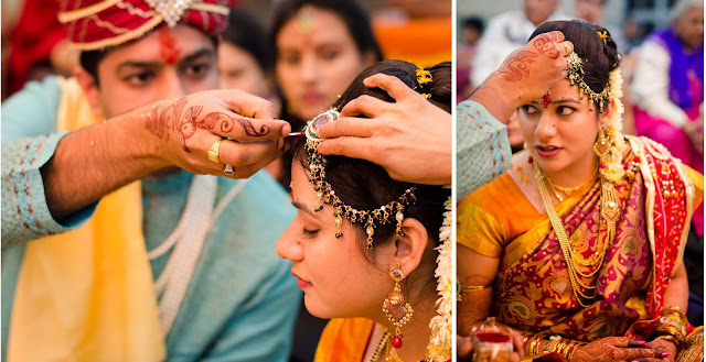The ritual of applying the Sindoor (a traditional cosmetic powder) as part of a Hindu Indian wedding. ( CC BY SA 3.0 ) Ceasing to wear this (and the red bindi) usually implies widowhood.