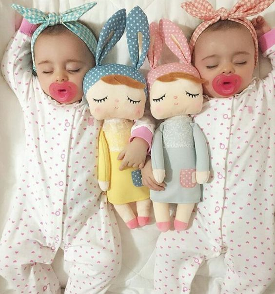 Cute Twin Baby Sleeping with Dolls