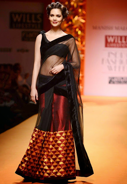 Bollywood Actress Esha Gupta in Simple Black with Red Net Lehenga Saree