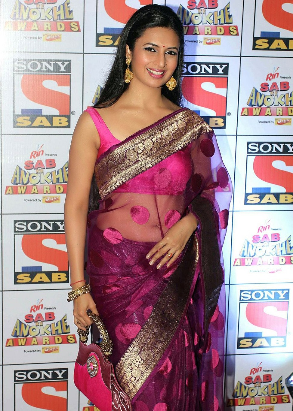 Indian TV Actress Divyanka Tripathi Long hair Hot Hip Navel Stills In Transparent Pink Saree