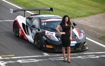 Wallpaper: Beautiful girl in front of Audi race car