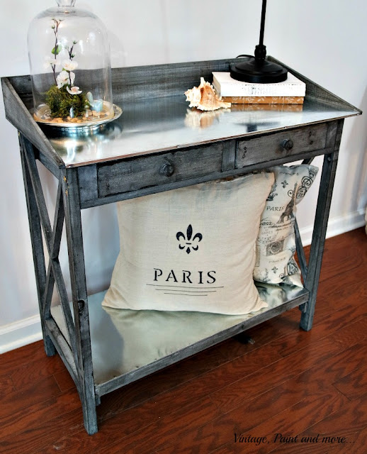 rustic table with galvanized sheeting for top and shelf used in a vintage industrial setting