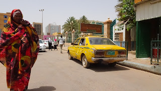 Walk in Khartoum and doesnt like being photographed