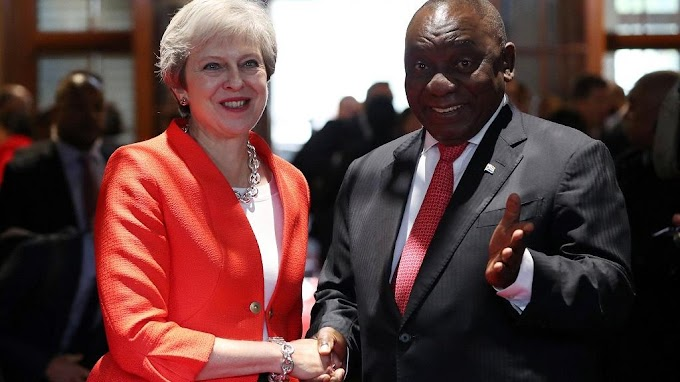 Theresa May dances in South Africa, says UK supports land reform