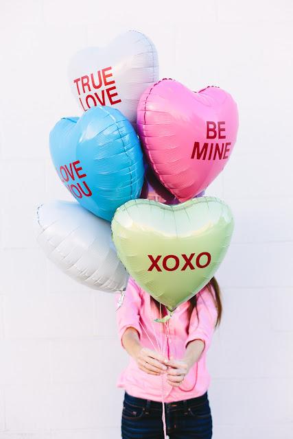 http://studiodiy.com/2014/01/30/diy-conversation-heart-balloons/