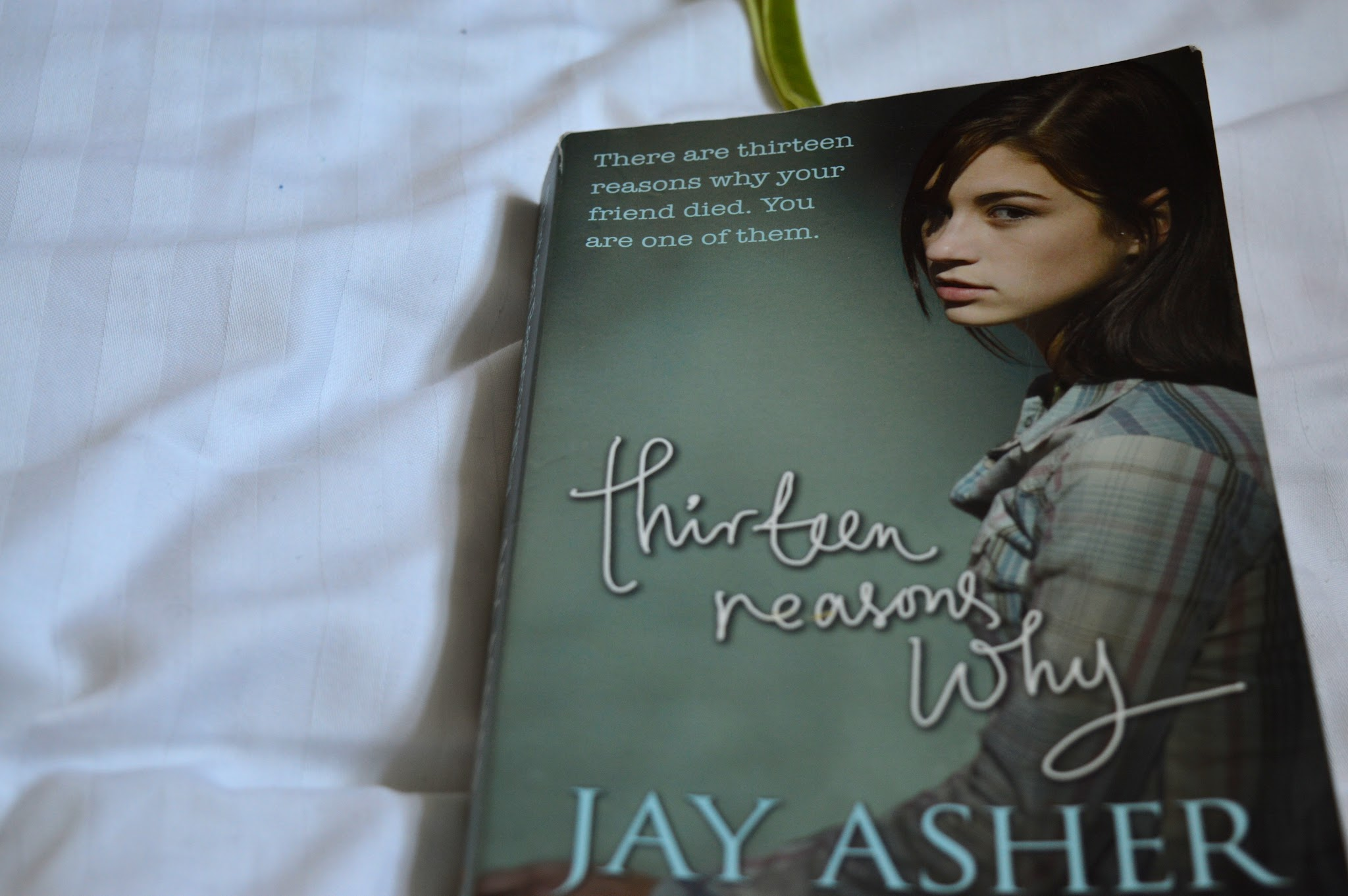 Thirteen Reasons Why by Jay Asher Paperback book image for book review