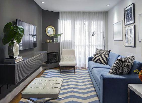 Decoração de sala de estar sofá azul