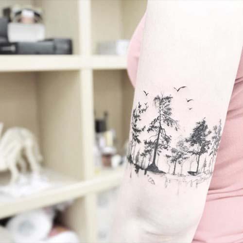 kadın üst kol ağaç dövmesi woman upper arm tree tattoo