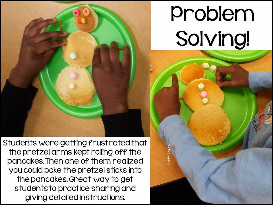 photo of students problem solving how to get the pretzels arms to stay on the pancake snowman