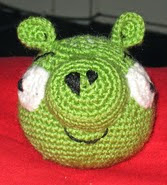 http://www.ravelry.com/patterns/library/angry-birds-evil-green-pig