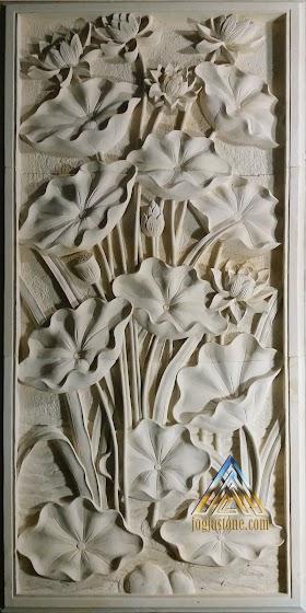 Ukiran bunga lotus batu putih
