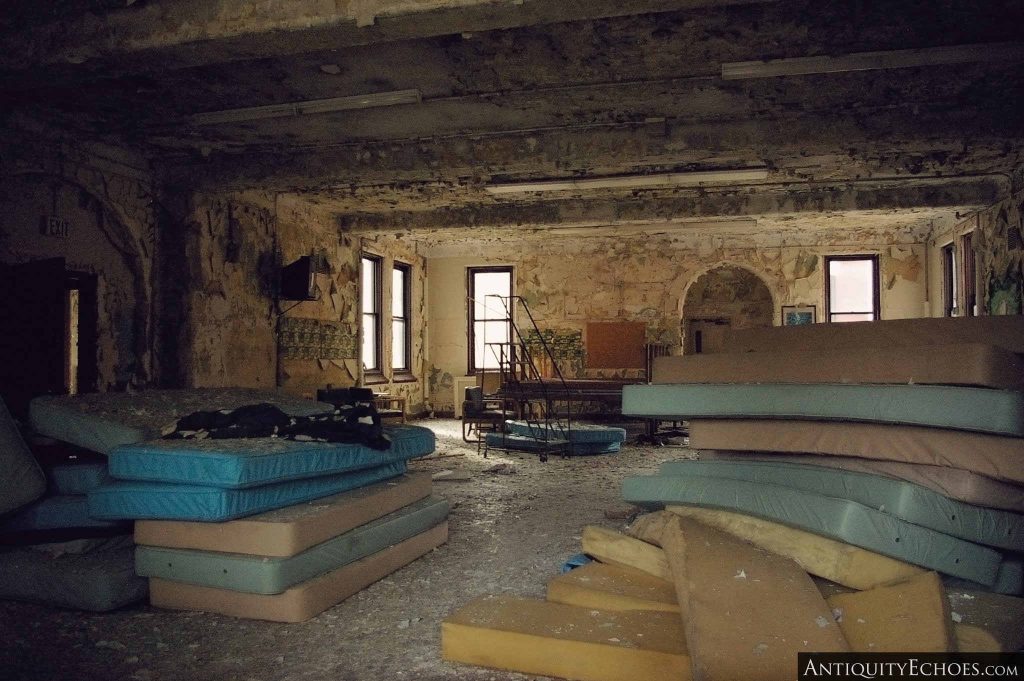 Overbrook Asylum - Disused Mattresses Stacked in a Dayroom
