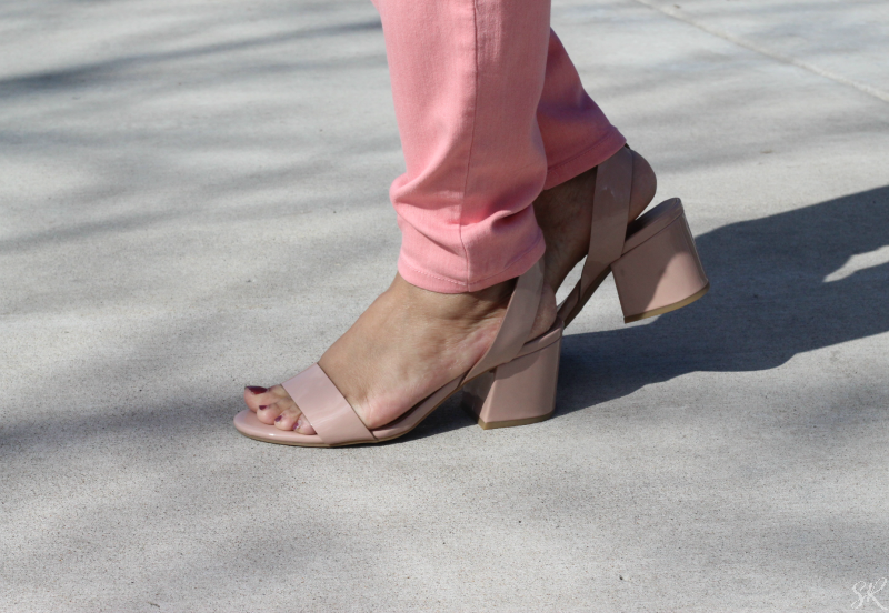 a woman wearing blush block heel sandals