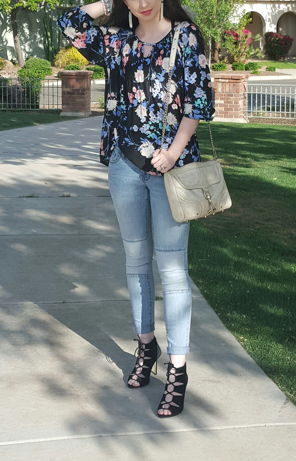Spring outfit idea- floral flowy top, lace up heels, and tassel earrings