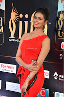 Meenakshi Dixit in Red One Shoulder Red Zipped up gown at IIFA Utsavam Award 02.JPG