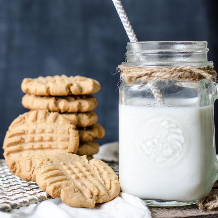Stack of peanut butter cookies and milk