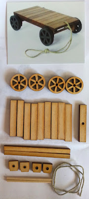 Photograph of a one-twelfth industrial trolley kit, with the kit pieces laid out beneath.
