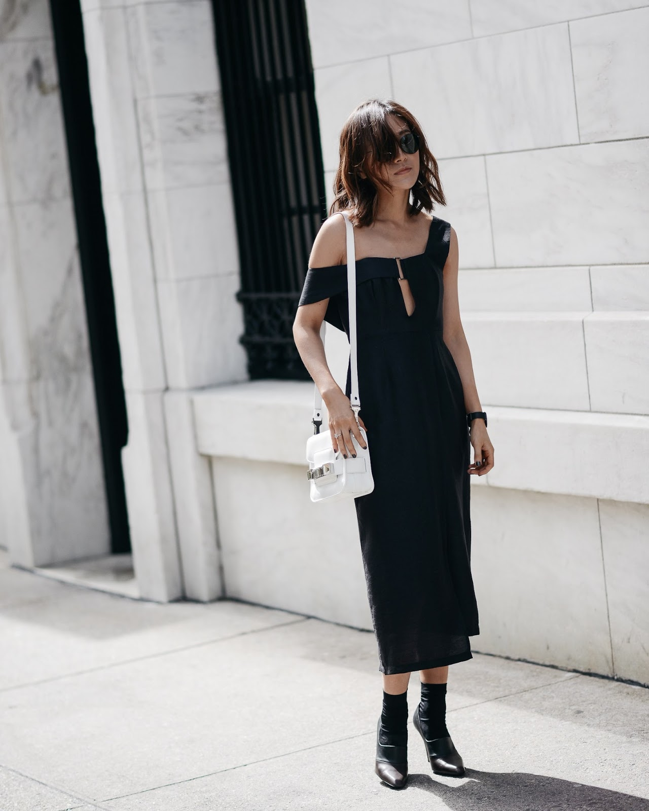 91ddfcc41dc Diana Z Wang is looking striking in this ultra elegant off the shoulder  black midi dress