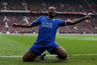 Wes Morgan celebrates after scoring the equaliser
