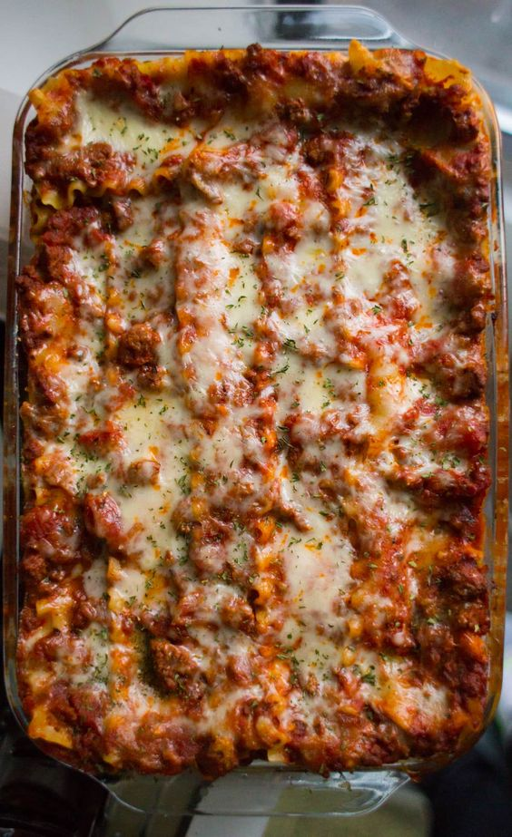 This is hands down the Best Lasagna Recipe ever! Easy, cheesy, meaty and so so delicious! Cuts perfect slices every time. Enjoy!