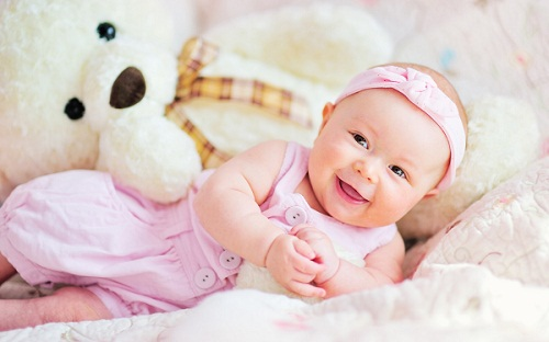Cute Baby Girl Playing with Teddy Bear