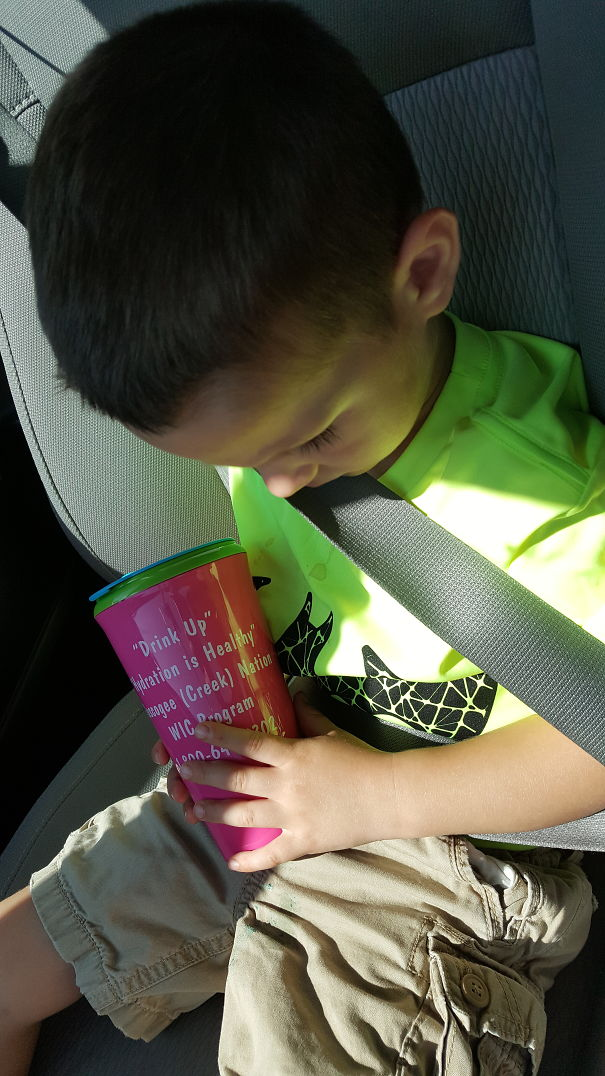 15+ Hilarious Pics That Prove Kids Can Sleep Anywhere - Sleeping And Drinking Mommys Water