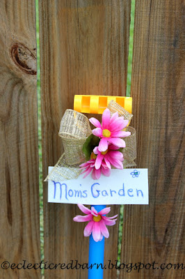 Eclectic Red Barn:Ribbon and flowers on the shovel