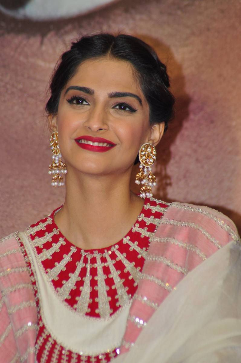 Sonam Kapoor Smiling Stills In White Dress