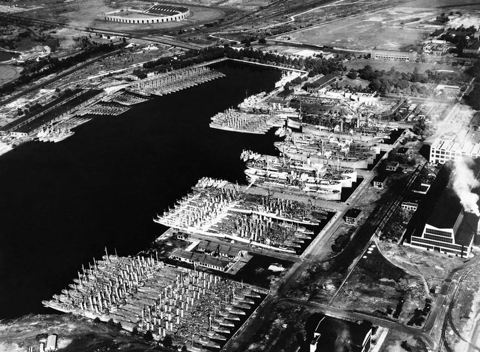 Outdated, but serviceable U.S. destroyers sit in the Back Bay at the Philadelphia Navy Yard, on August 28, 1940. Plans were well underway to bring these ships up to date and transfer them to Allied countries to aid their defense. These programs would be signed into law as the Lend-Lease program in March of 1941, and would result in billions of dollars worth of war material being shipped overseas.