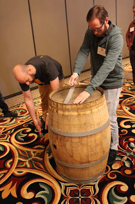 Removing the head from a barrel.