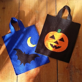 Picture of two trick or treat bags I made, a blue one with a bat and moon and a black one with an orange pumpkin