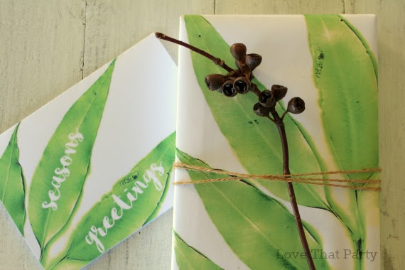 image of gift with gum leaves and gumnuts tied with twine