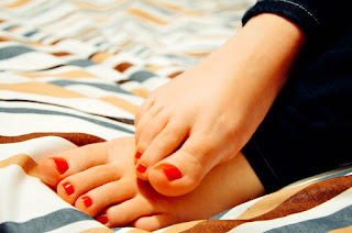 woman's feet with red nail polish.jpeg