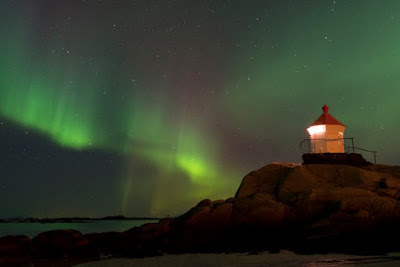 Northern Lights over a lighthouse