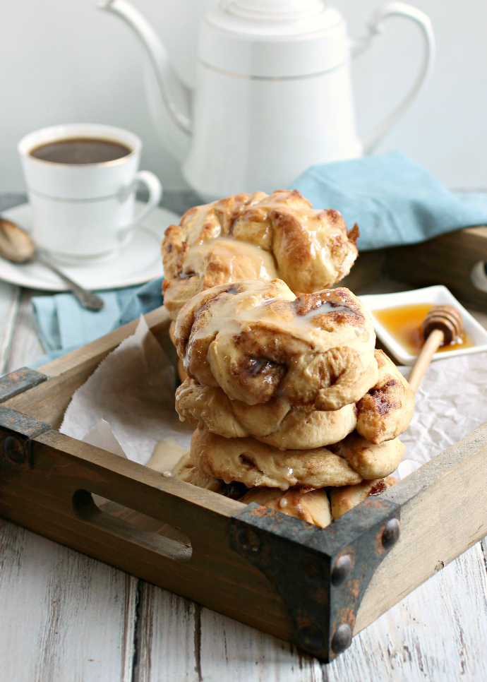 Recipe for sweet yeast buns rolled with honey and cinnamon and topped with a cinnamon honey glaze.