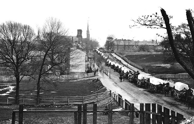 Petersburg, Virginia, the first Federal army wagon train entering the town in April of 1865.