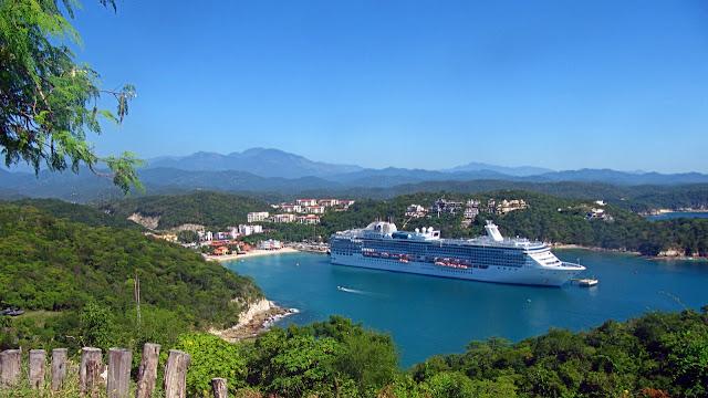 A cruise ship nestled in the port of Santa Cruz...