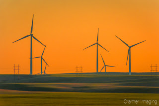 Cramer Imaging's landscape photograph of windmills or wind turbines in a field at sunset in Ririe, Idaho