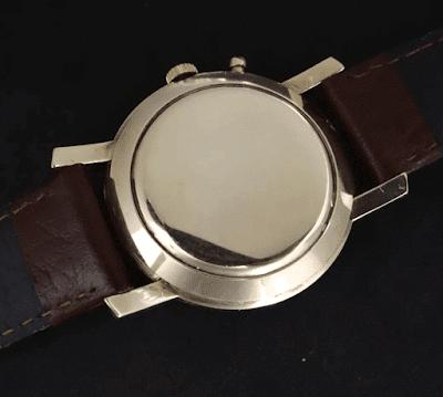 TAPA_oro_Reloj_Tissot_Navigator_1953_horario_mundial_oro14k