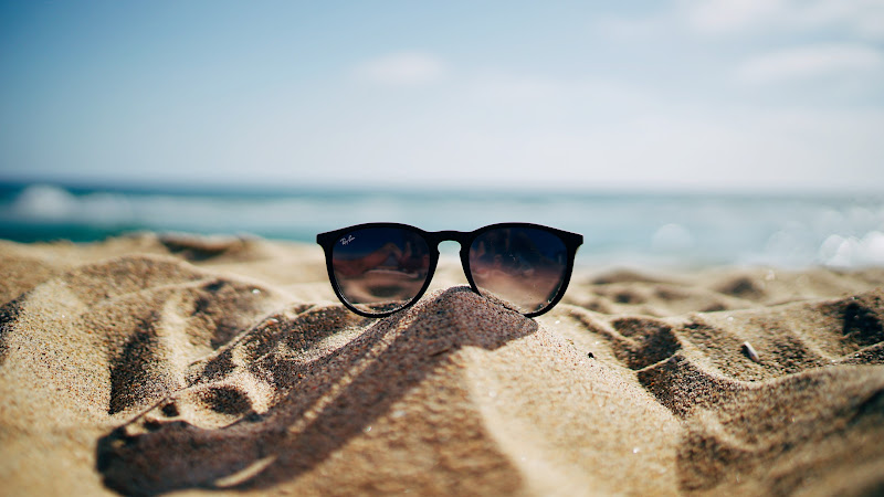 Ray-Ban Sunglasses on Hot Sand Beach