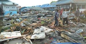 Mass Burials In Indonesia As Tsunami-Quake Death Toll Hits 832