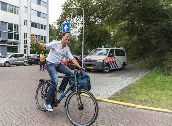 Prime Minister Of Netherlands,Mark Rutter Going To Work On A Bike.