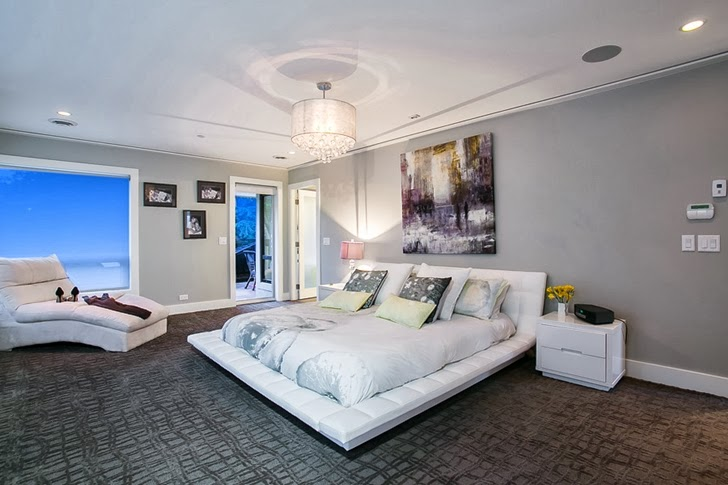 White modern bed in Contemporary home by Trevor Euley in Canada