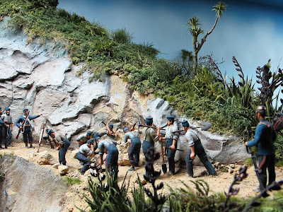 Diorama of 19th-century soldiers fixing a landslide on a track.