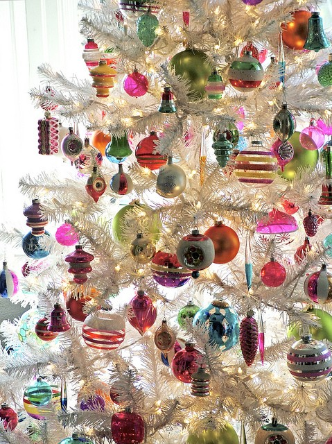 Colorful ornaments on festive white Christmas tree #FrenchChristmas #ParisChristmas